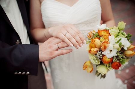 beautiful wedding bouquet of flowers in the hands of the bride Stock Photo