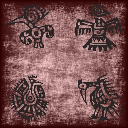 mexican traditional aztec bird motif on a grunge background photo