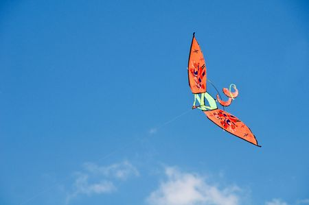 colorful cloudscape: Flying kite Stock Photo