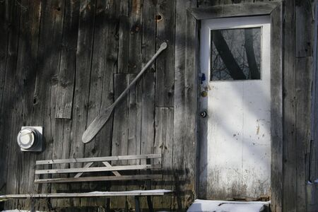 Weathered shed with white door Stock Photo