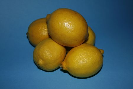 Lemons on a Blue Backgrou Stock Photo
