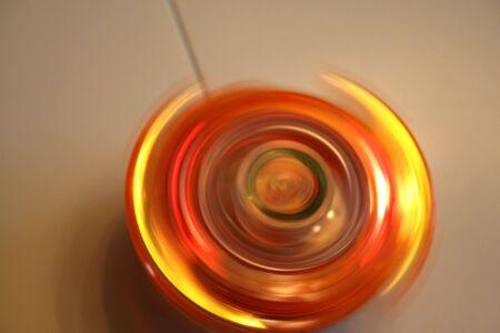 Orange Spinning Top Stock Photo