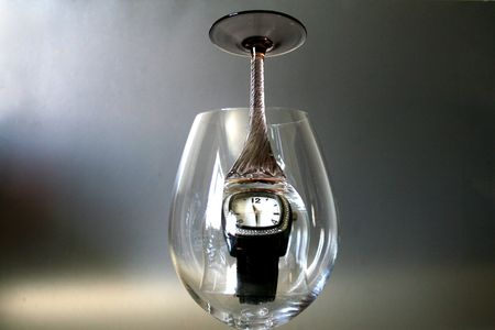 A Watch In A Sherry Glass Inside A Wine Glass Stock Photo