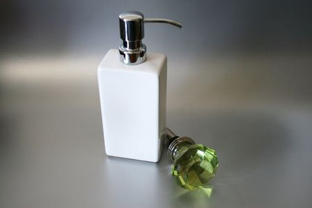 A White Hand Soap Dispensor With Green Wine Stopper