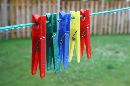 Five Pegs Hanging On A Clothes Line Stock Photo