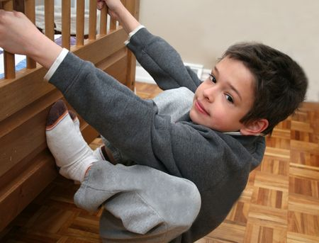 Young boy elevating himself off the floor