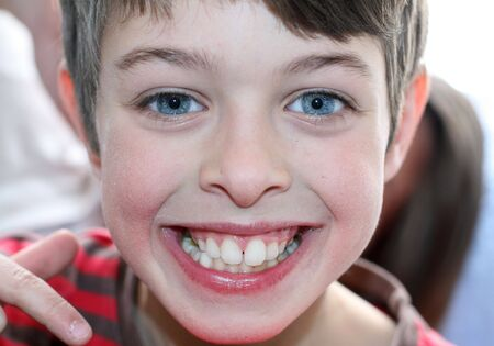 Boy with blue eyes is smiling  Stock Photo