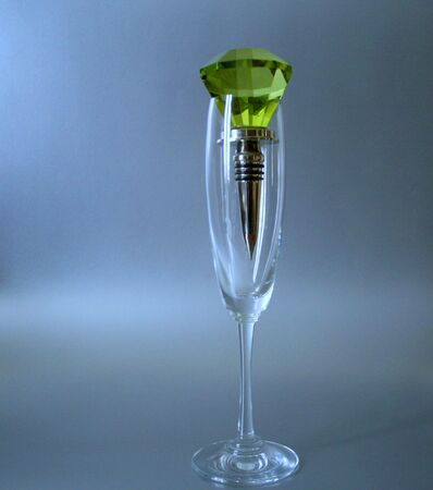 Champagne glass with green glass stopper Stock Photo