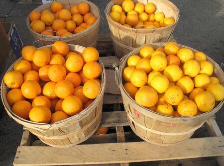 Oranges in round wood crates Stock Photo