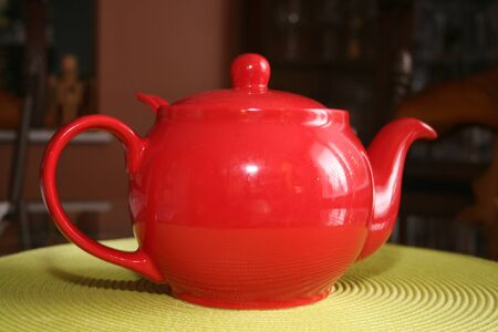 Red teapot on table