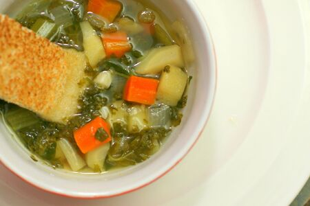 Bowl of kale and vegetable soup