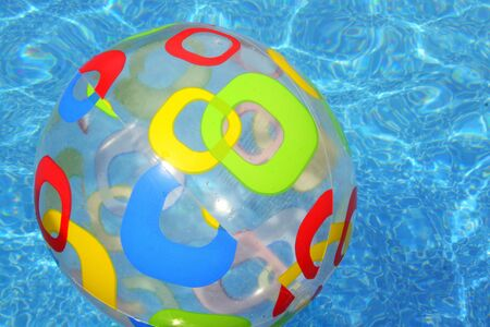 ,Colorful beach ball floating on top of the pool Imagens