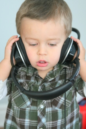 Baby with headphones listening to music photo