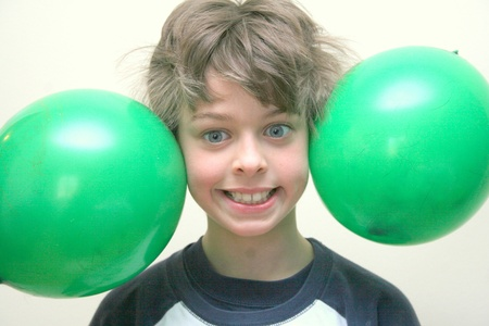 Boy with balloon static on hair Stock Photo