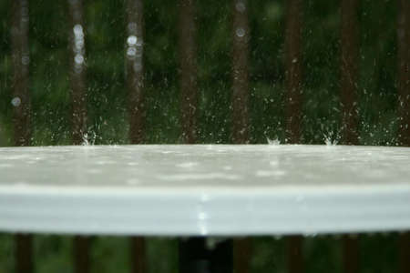 Bouncing raindrops on white table