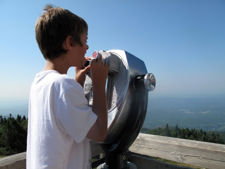 Boy  at a lookout in Mont Tremblant