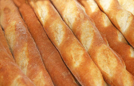 Baguettes or french bread behind a window
