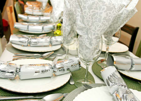 Holiday dining table decor in silver and gold Stock Photo