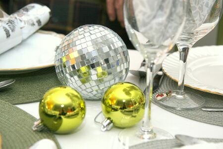 Chartreuse and mirrored ornaments decorating a table