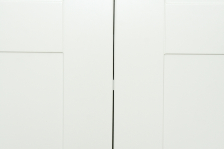 Closeup of white wood cabinets in kitchen