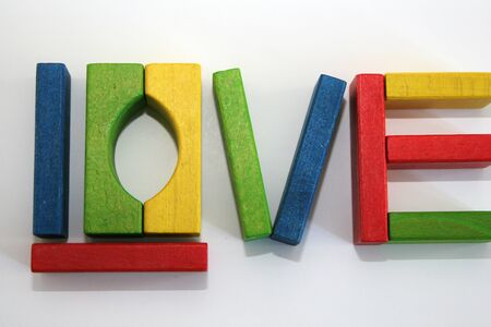 Colorful wooden blocks spell Love Stock Photo