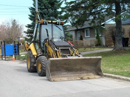 Bulldozer on city street ready for excavating Stock Photo