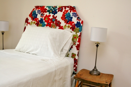 Colorful headboard with lamps on antique chairs