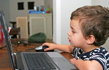 Toddler looking at computer