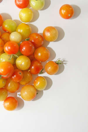 Multicolored cherry tomatoes on a white background