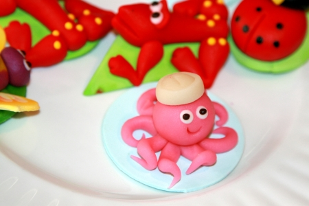 Marzipan animal characters on white plate