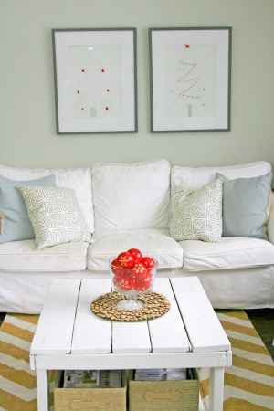 Decorator sofa, pillows, and white wood table