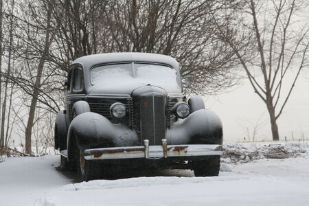 Vintage classic car covered in winter Stock Photo