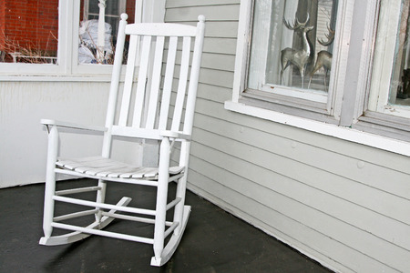 White rocking chair on old-fashioned balcony