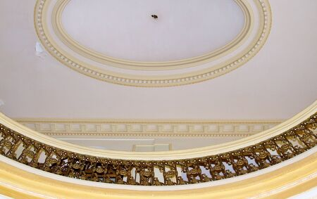 Elaborate oval gold design on ceiling