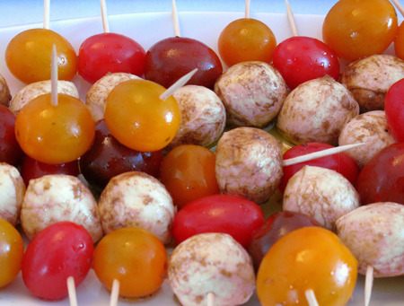 Bocconcini and cherry tomatoes marinated in olive oil, garlic and balsamic vinegar