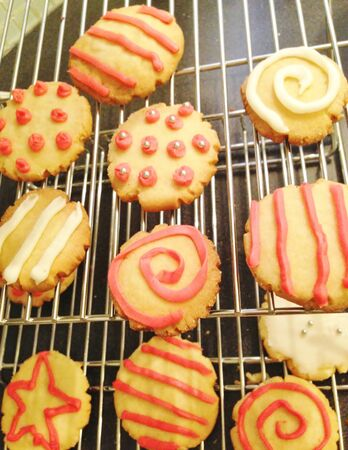 Shortbread cookies decorated with  royal icing on cooling rack Stock Photo