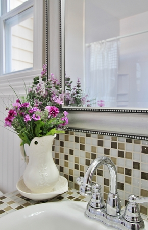 Elegant country bathroom with purple flowers in vase