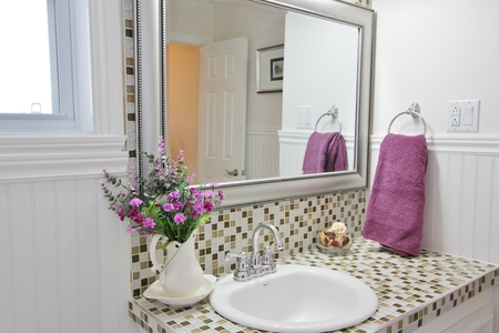 Elegant country bathroom with purple towels