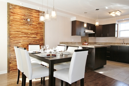 designer: Kitchen and modern dining room with back panel made in horizontal wood strips Stock Photo