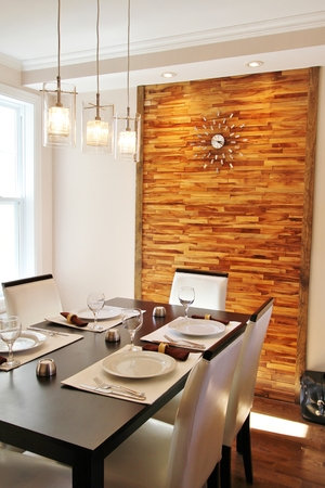 Modern dining room with back panel made in horizontal wood strips