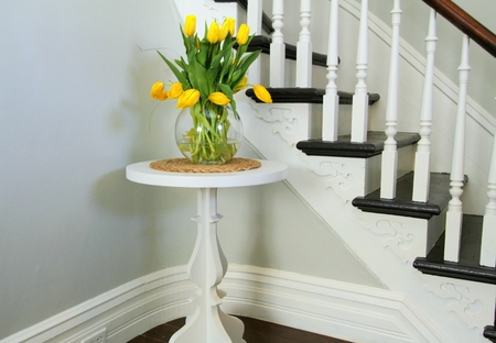 Yellow tulips on a round table besi Stock Photo