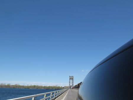 View of bridge and highway in the rear of car