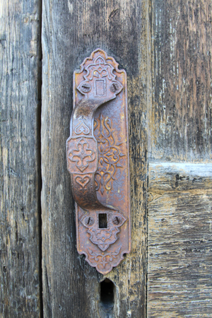 Antique handle on old wood door