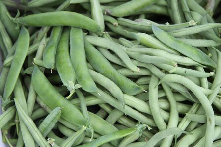 Closeup of green peas in pods and green string beans