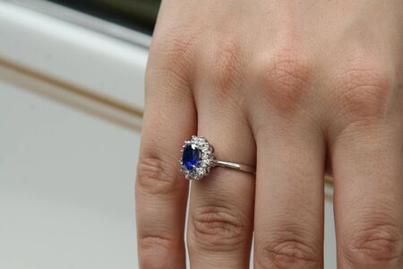 Saphire and diamand wedding ring on a finger