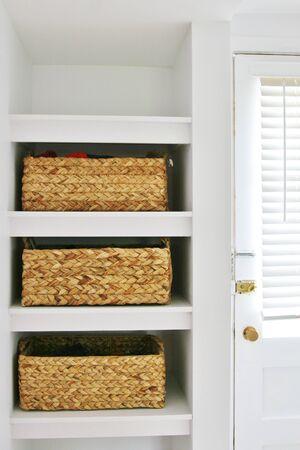 Modern rattan baskets in shelves