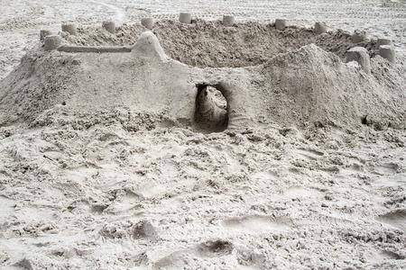 Sandcastle constructed on a sandy beach