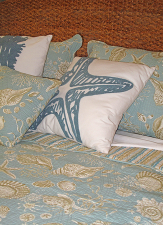 coverlet: Beachy bedding and pillows in tones of blue