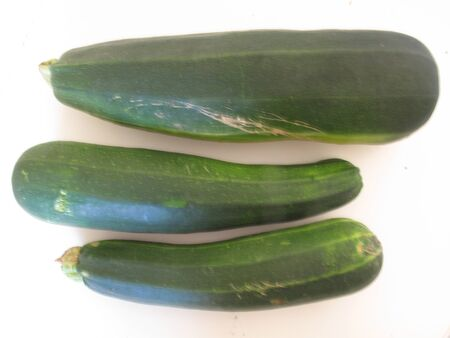Different sizes of zuchini on white background