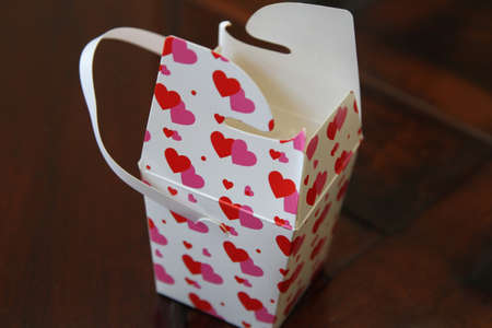 Red and pink hearts with delicate paper gift box with handle Stock Photo